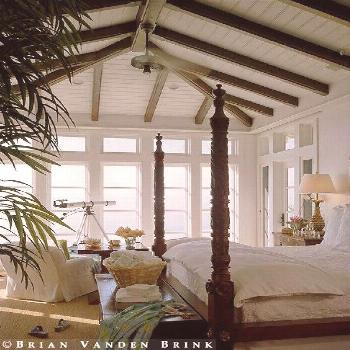 light, bright and serene ocean front british colonial style bedroom features tongue in groove ceili