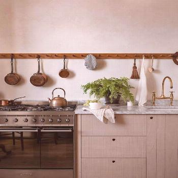 This kitchen is all about natural materials. Bandsawn British beech cupboards, Carrara marble workt